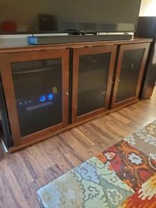 "Entertainment cabinet with 3 doors. 66 x 20 x 31"" tall."