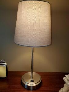A pair of matching bedside lamps with USB ports.