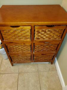 "Wood Storage cabinet with 6 baskets. 27 x 14 x 31"" tall."