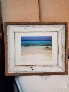 Framed photo of Key West in a weathered wood frame.