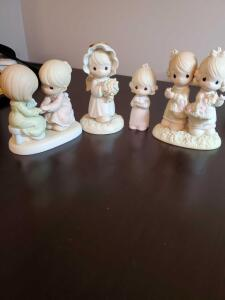 Four precious moments figurines, 2 trinket boxes, Oct girl, and seraphim figurine.