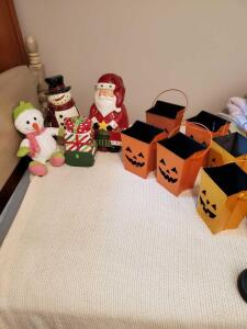 Three Christmas cookie jars, a stuffed plush snowman, and six Halloween luminaries.