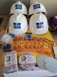 4 new and unused hard hats, 14 hand warmers, misc electrical supplies,