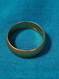 14 Karat gold wedding band size 7