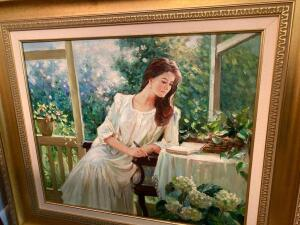 Framed oil painting of woman reading