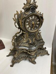 Battery run decorative brass clock, very heavy