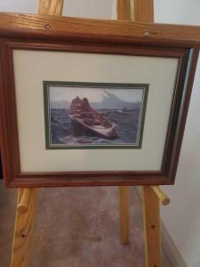 "A framed and matted print of a fisherman at sea, 14"" x 17"""