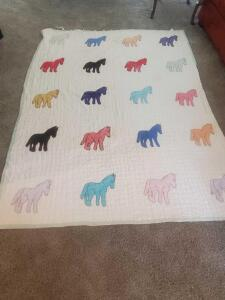 "Handmade quilt with embroidered horses. 87"" x 71"""