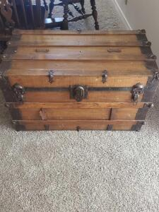 "A vintage wooden trunk, 20"" tall, 34"" across, 18"" front to back"