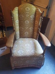"An antique upholstered chair with a skirt, seat is 17"" tall, back is 43"" tall, 28"" across, 24"" front to back"