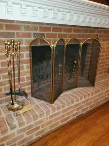 Polished brass look fireplace screen and tools.
