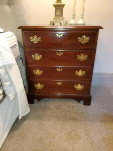 "White furniture 4 drawer nightstand. 26x16x30"" tall."