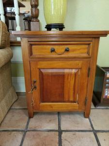 "End table with one drawer and storage. 25x17x29"" tall."