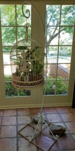Decorative birdcage with stand.