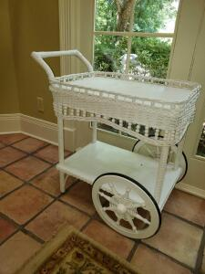 "Lovely white wicker tea cart. 17x31x32"" tall including handle."