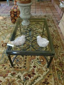 "Iron base coffee table with beveled glass top. 42x27x19"" tall."
