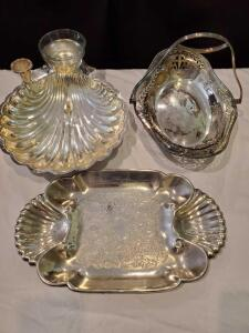 3 silverplate serving pieces. Handled basket, shell dish, tray.
