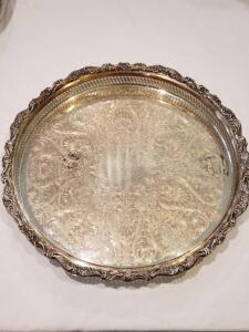 "Round Serving tray. 15"" silverplate and Beautifully detailed with pierced sides and scroll work."