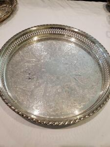 "Footed Round Serving tray. 15"" silverplate and Beautifully detailed with pierced sides and scroll work."
