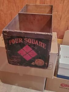 "A vintage ""four square"" crate, 12"" tall, 26"" across, 12"" wide"