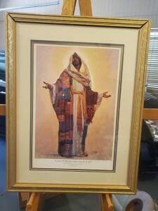 "A framed and matted print of Jesus from the master peace collection, titled ""coat of many colors, Lord of all,"" 30 x 23 (frame needs some small repair"
