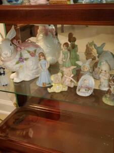 Shelf of collectibles. Rabbit, enesco, and others.