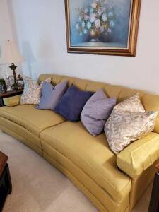Wonderful gold/green with blue stitches curved back sofa with pillows. 4 of the pillows are down/feather.
