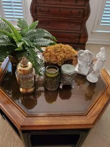 Figurines, ships lantern style musical jar, etc. Items on coffee table.