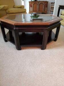 "Octagon shape coffee table with glass top. 37x15"" tall."