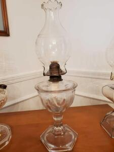 "Old oil lamp with replacement globe. Lamp is 12"" - globe is 9""."
