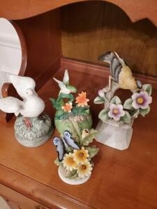 Porcelain birds and butterfly. Goldfinch and butterfly are Lefton china.