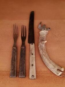 Grandfather's Antique forks and knife from Germany and a deer horn bottle opener.