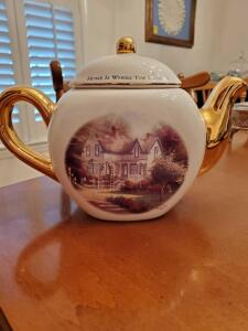 "Thomas kinkade teapot with gold spout and handle titled home is where the heart is. 6"" tall."
