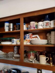 Kitchen cabinet contents as pictured.