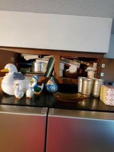 Cabinet contents above refrigerator.