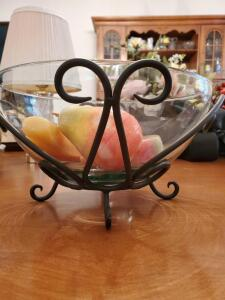 "Bowl of onyx fruit in a metal holder. 10"" x 5"" tall."
