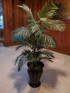 "Silk palm plant in urn style pot. 11x48"" tall."