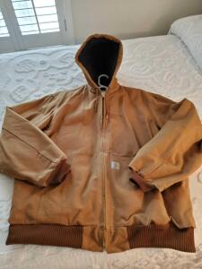 Men's Carhartt canvas jacket with attached hood in size extra large tall.