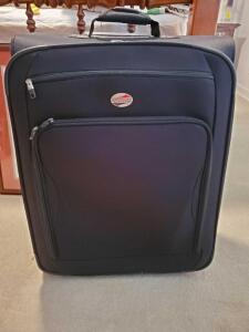 "American tourister 26"" expandable wheeled suitcase."