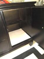 Three drawer black sideboard with storage, items on top not included - 3