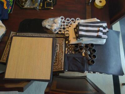 Collection of black and white placemats, table linens and napkin rings
