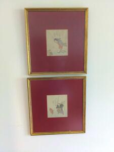 Pair of embossed paper artwork with mauve felt matte