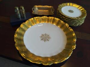 Gold entertaining set with Limoges dishes