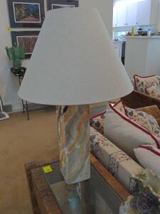 Ceramic tabletop lamp with marble finish and linen shade