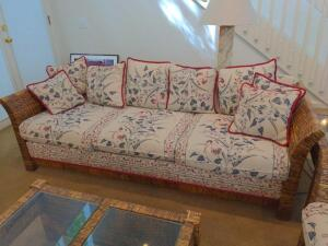 Wicker rattan and floral fabric sofa