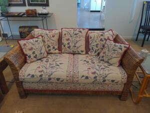 Wicker rattan and floral fabric loveseat