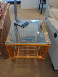 Rattan glass top end table with bottom shelf (items on Table not included )