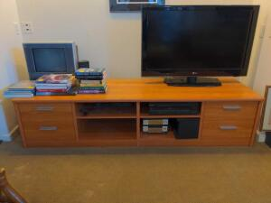 Extended four-drawer entertainment center with center storage (contents in drawers and in photo not included)