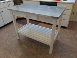 Kitchen utility island with stainless top, storage drawer and towel rack