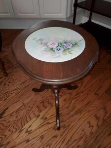 Beautiful tilt top oval table with hand-painted center.